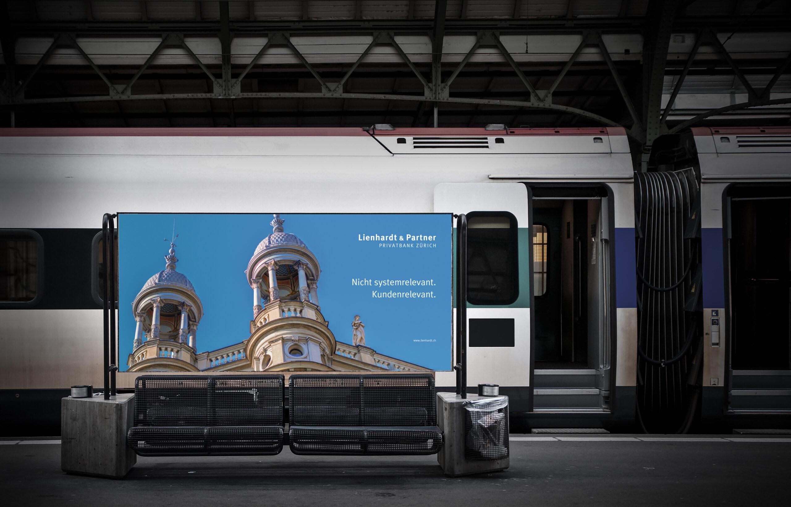 blank billboard in a train station